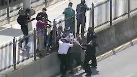 NYPD seeks man who attacked police with wooden object during Brooklyn Bridge protest