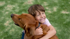 New report claims that kids who grow up with dogs are better behaved