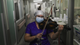 Chilean nurse plays violin for coronavirus patients, exhausted staff after finishing shift