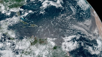 Tropical Depression 5 accelerates away from Bermuda, may become next tropical storm