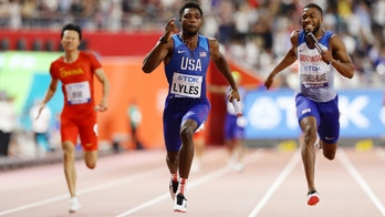 American sprinter Noah Lyles briefly tops Usain Bolt's world record after lane mixup