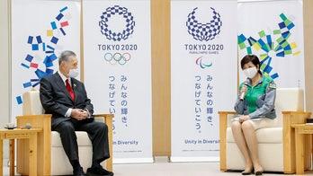 Tokyo governor: Japan can host Olympics despite virus spike