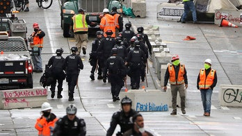 Seattle police arrest 10 after clashes in cleared CHOP zone