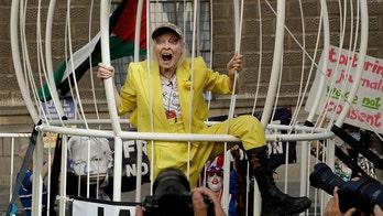 Designer Vivienne Westwood supports Julian Assange with odd protest in massive birdcage
