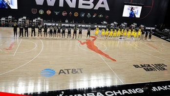 WNBA players walk off court during national anthem ahead of season opener