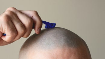 Man shaves girlfriend's head, then his own, in moving video