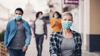 Face mask political debate becomes public flashpoint propelled by social media
