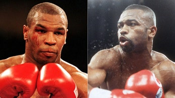 Mike Tyson, Roy Jones Jr. fight to a draw in boxing spectacle