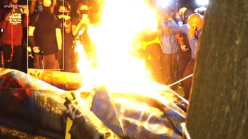 Court docs allege 'ringleader' of statue vandals lit a cigarette with monument's flames