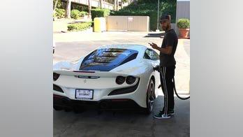 Swizz Beatz spotted filling up his new Ferrari