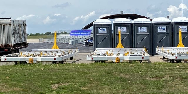 A long range view on Friday of the Trump campaign's site for Saturday night's rally with the president at Portsmouth International Airport in New Hampshire. The rally has been postponed due to severe weather concerns.