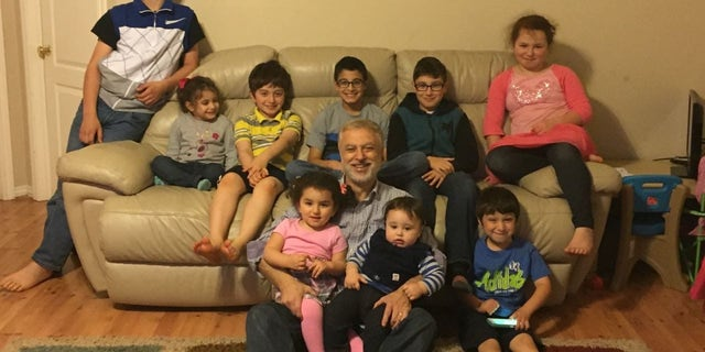 Happier times: Majd Kamalmaz with his grandchildren in the U.S.
