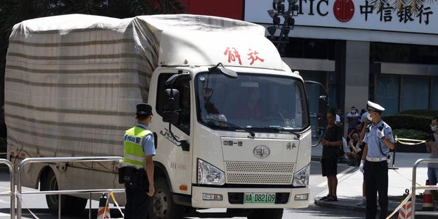 """A movers' truck with the words """"Liberation"""" on top arrives outside the United States Consulate in Chengdu in southwest China's Sichuan province on Sunday, July 26, 2020. China ordered the United States on Friday to close its consulate in the western city of Chengdu, ratcheting up a diplomatic conflict at a time when relations have sunk to their lowest level in decades."""