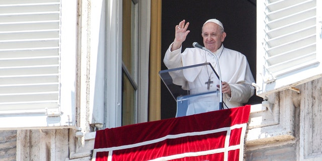 Pope Francis waves to faithful from his studio window overlooking St. Peter's Square at the Vatican, as he leaves at the end of the Angelus prayer, July 5. (AP Photo/Riccardo De Luca)