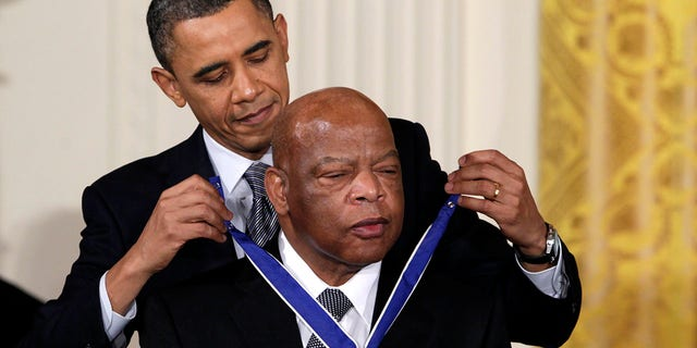 In this Feb. 15, 2011, photo, President Barack Obama presents a 2010 Presidential Medal of Freedom to U.S. Rep. John Lewis, D-Ga., during a ceremony in the East Room of the White House in Washington. Lewis, who carried the struggle against racial discrimination from Southern battlegrounds of the 1960s to the halls of Congress, died Friday, July 17, 2020. (AP Photo/Carolyn Kaster, File)