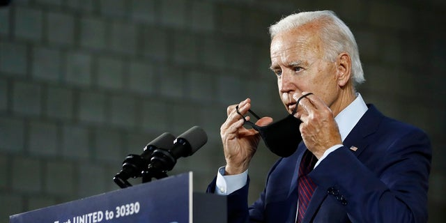 Democratic presidential candidate, former Vice President Joe Biden, puts on a face mask after speaking at an event in Lancaster, Pa. (AP Photo/Matt Slocum)