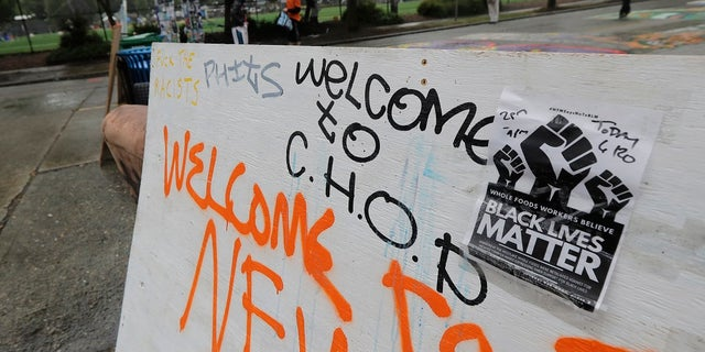 "A sign on a makeshift barricade reads ""Welcome to C.H.O.P."" after Seattle Department of Transportation workers removed concrete barricades at the intersection of Tenth Avenue and Pine Street at the CHOP (Capitol Hill Occupied Protest) zone in Seattle. The area has been occupied by protesters since Seattle Police pulled back from their East Precinct building following violent clashes with demonstrators earlier in the month. (AP Photo/Ted S. Warren)"