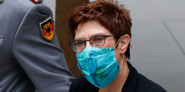 Defense Minister Annegret Kramp-Karrenbauer (CDU) arrives at a press conference on the reform of the Special Forces Command (KSK), wearing mouth and nose protection, Berlin Germany, Wednesday, July 1, 2020. Since 2017, the KSK has been making headlines because of several cases of right-wing extremism. One suspected soldier even had an arsenal dug up. The Defence Minister has therefore had a reform concept developed to counteract extremist tendencies. (Kay Nietfeld/dpa via AP)
