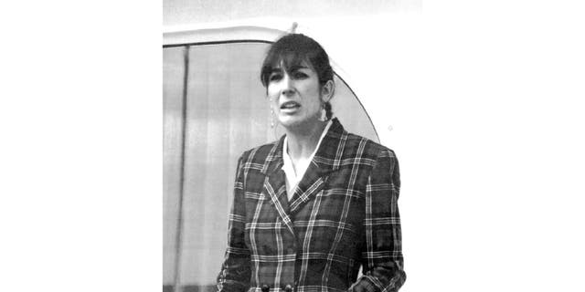 """Nov. 7, 1991: Ghislaine Maxwell, daughter of late British publisher Robert Maxwell, reads a statement in Spanish in which she expressed her family's gratitude to the Spanish authorities, aboard the """"Lady Ghislaine"""" in Santa Cruz de Tenerife. (AP Photo/Dominique Mollard)"""