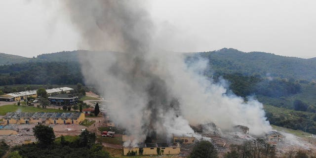 Smoke billows from a fire following an explosion at a fireworks factory outside the town of Hendek, Sakarya province, northwestern Turkey, Friday July 3, 2020.