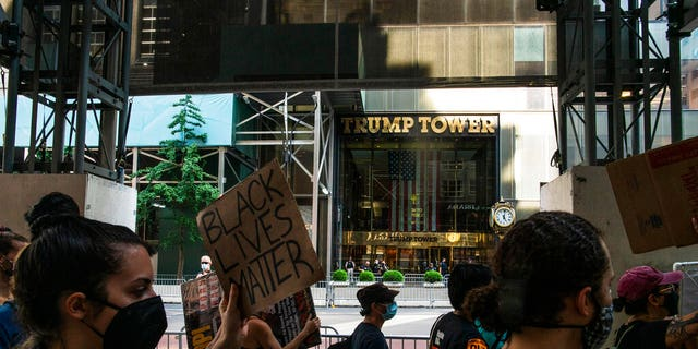 Protesters arrive to Trump Tower on Fifth Avenue during a protest, Saturday, July 4, 2020, in New York.