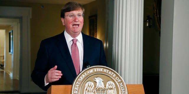 FILE: Mississippi Gov. Tate Reeves delivers a televised address prior to signing a bill retiring the last state flag in the United States with the Confederate battle emblem, during a ceremony at the Governor's Mansion in Jackson, Miss.
