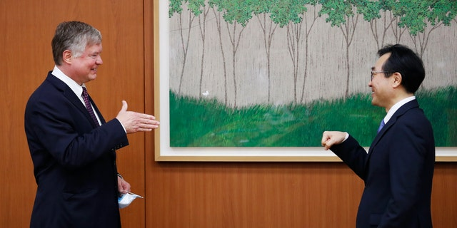 U.S. Deputy Secretary of State Stephen Biegun is greeted by his South Korean counterpart Lee Do-hoon during their meeting at the Foreign Ministry in Seoul, South Korea, July 8, 2020. REUTERS/Kim Hong-Ji/Pool