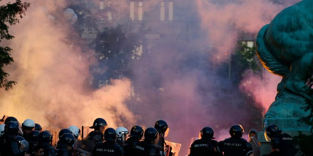 Serbian riot police clashes with protesters in Belgrade, Serbia, Wednesday, July 8, 2020. (AP Photo/Darko Vojinovic)