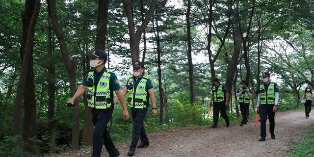 Police officers search for missing Seoul Mayor Park Won-soon in Seoul, South Korea, Thursday, July 9, 2020. (Kim Ju-sung/Yonhap via AP)