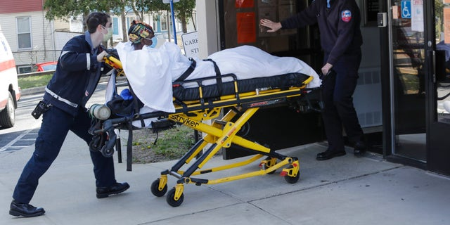 election 2020  Donald Trump  President Trump  Conservative News  RNC Medical workers bring a patient to the Northbridge Health Care Center in Bridgeport, Conn on April 22, 2020. (AP Photo/Frank Franklin II)