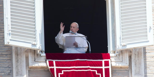 Pope Francis delivers his blessing to faithful during the Angelus prayer from the window of his studio overlooking St. Peter's Square at the Vatican, Sunday, July 12, 2020. (AP Photo/Alessandra Tarantino)