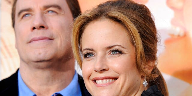 "Kelly Preston, right, a cast member in ""The Last Song,"" with her husband John Travolta at the premiere of the film in Los Angeles on March 25, 2010. Actress Kelly Preston, whose credits included the films ""Twins"" and ""Jerry Maguire,"" died Sunday, July 12, 2020, her husband John Travolta said. She was 57. (AP Photo/Chris Pizzello, File)"