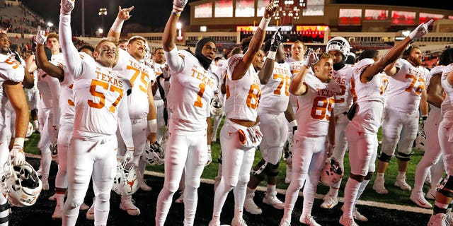 """FILE: Texas players sing """"The Eyes of Texas"""" after an NCAA college football game against Texas Tech in Lubbock, Texas."""
