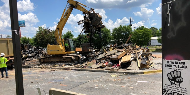 A Wendy's restaurant is demolished Tuesday, July 14, 2020, in Atlanta. The resaurant was the scene where Rayshard Brooks was shot and killed on June 12, 2020, by an Atlanta police officer following a struggle during a DUI arrest. (AP Photo/Jeff Amy)