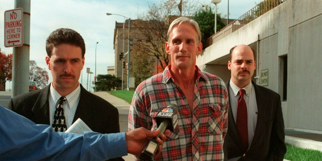 In this 1998 photo, Wesley Ira Purkey, the center of Kansas City, Kan., Was escorted after he was arrested in connection with the death of 80-year-old Mary Ruth Bales.  (AP / The Kansas City Star)