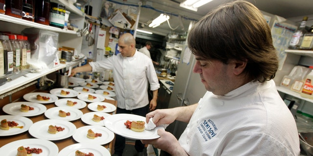 In this 2012 file photo, chef and owner Josiah Slone, right, prepares a foie gras dish at Sent Sovi restaurant in Saratoga, Calif. Foie gras is back on the menu in California after a judge ruled the rich dish can't be prevented from being brought in from out of state. (AP Photo/Marcio Jose Sanchez, File)