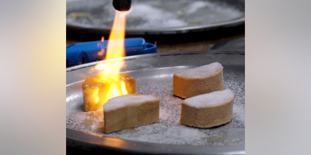 Foie gras is torched and made into a Brulee at the Sent Sovi restaurant in Saratoga, Calif. (AP Photo/Marcio Jose Sanchez, File)