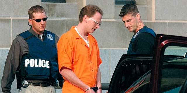 Dustin Honken is led by federal marshals to a waiting car after the second day of jury selection in federal court in Sioux City, Iowa on Aug. 18, 2004. (Tim Hynds/Sioux City Journal via AP, File)