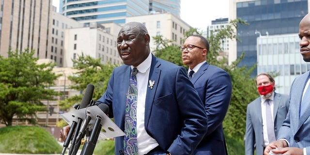 Attorney Ben Crump speaks during a news conference Wednesday in Minneapolis accompanied by co-counsel members, announcing a civil lawsuit against the city of Minneapolis and the officers involved in the death of George Floyd on Memorial Day. (AP Photo/Jim Mone)
