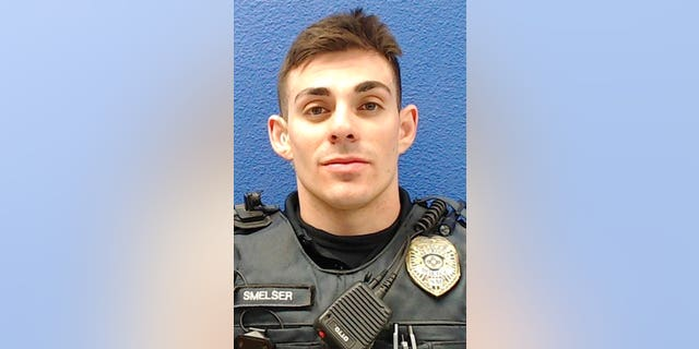 This undated photo provided by the Las Cruces Police Department shows former officer Christopher Smelser, who has been charged with second-degree murder after authorities say he killed a detainee he had placed in a chokehold. (Las Cruces Police Department via AP)