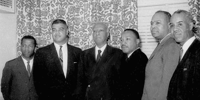 Six leaders of the nation's largest black civil rights organizations pose are seen at the Roosevelt Hotel in New York City, July 2, 1963. From left are: John Lewis, chairman Student Non-Violence Coordinating Committee; Whitney Young, national director, Urban League; A. Philip Randolph, president of the Negro American Labor Council; Martin Luther King Jr., president Southern Christian Leadership Conference; James Farmer, Congress of Racial Equality director; and Roy Wilkins, executive secretary, National Association for the Advancement of Colored People. (Associated Press)