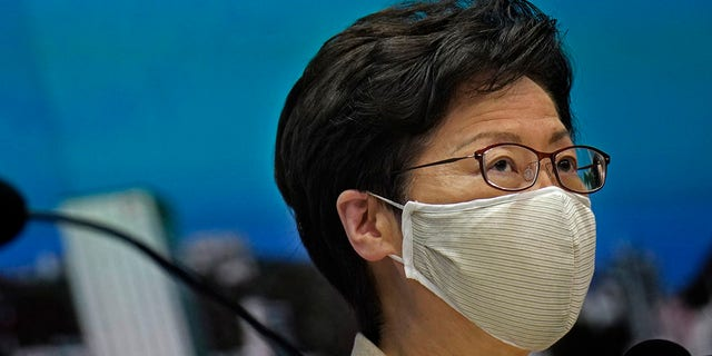 Hong Kong Chief Executive Carrie Lam listens to reporters questions during a press conference held in Hong Kong, Sunday, July 19, 2020. (AP Photo/Vincent Yu)