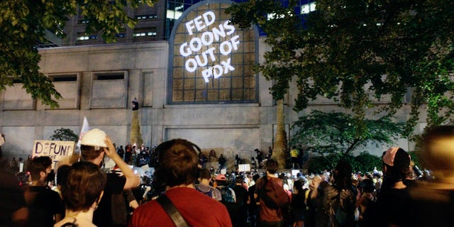 Protesters projected these words on the front of the Multnomah County Justice Center, Monday, July 20, 2020 in Portland, Ore. (AP Photo/Gillian Flaccus)