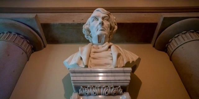 Marble bust of Chief Justice Roger Taney is displayed in the Old Supreme Court Chamber in the U.S. Capitol in Washington. The House will vote Wednesday, July 22, on whether to remove from the U.S. Capitol
