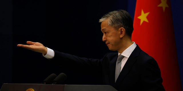 Foreign Ministry spokesperson Wang Wenbin gestures for questions during a daily briefing in Beijing Thursday, July 23, 2020. China ordered the United States on Friday, July 24, 2020 to close its consulate in the western city of Chengdu, ratcheting up a diplomatic conflict at a time when relations have sunk to their lowest level in decades. (AP Photo/Ng Han Guan)