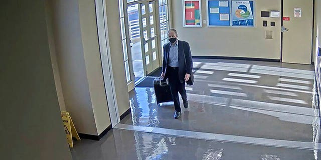 This July 11, 2020 surveillance photo provided by the San Bernardino County Sheriff's Department shows who is believed to be Roy Den Hollander, passing through Union Station in Los Angeles. (Courtesy of San Bernardino County Sheriff's Department via AP)