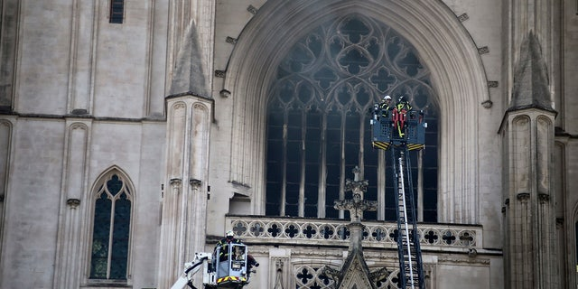 In this photo, taken on July 18, 2020, a fire brigade is working to extinguish the flames in the Gothic cathedral