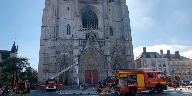 French authorities detained and charged a repentant church volunteer on Sunday, July 26, 2020, after he told investigators he was responsible for an arson attack that severely damaged a 15th-century Gothic cathedral.  (AP Photo / Laetitia Notarianni, File)