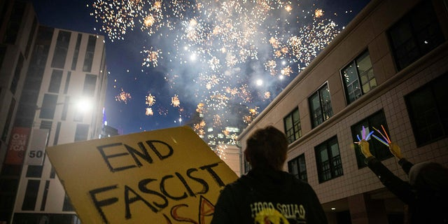 Protesters light fireworks in the middle of downtown Oakland during a protest on Saturday, July 25, 2020, in Oakland, Calif. (Associated Press)
