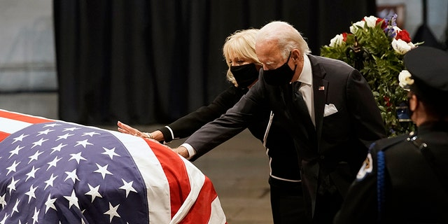 Democratic presidential candidate, former Vice President Joe Biden and Jill Biden touch the flag-draped casket of the late Rep. John Lewis, D-Ga., a key figure in the civil rights movement and a 17-term congressman from Georgia, as he lies in state at the Capitol in Washington, Monday, July 27, 2020. (AP Photo/J. Scott Applewhite, Pool)